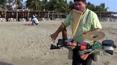 Guantanamera performed by a one man band on the beach in