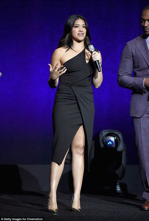 Gina Rodriguez wears sexy thigh-split dress at CinemaCon