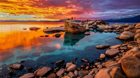 Candy colored skies sunset at shoreline of Lake Tahoe
